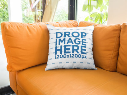 Square Pillow Template Lying on an Orange Sofa in a Living Room a14921