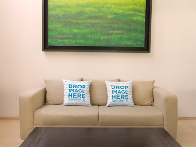 Two Pillows Template on a Sofa Below a Green Art Print a14919