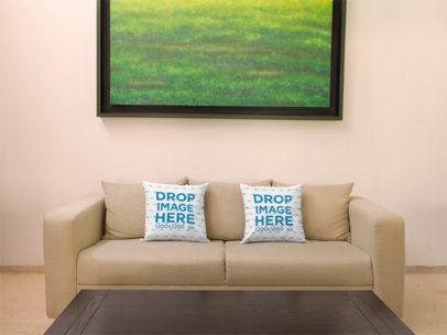 Two Pillows Template on a Sofa Below a Green Art Print a14919