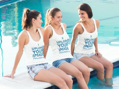 Three Girlfriends Wearing Different Tank Tops Mockup Chatting by the Edge of a Pool a15487