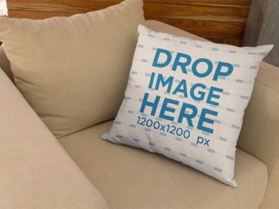 Mockup of a Pillow Lying on a Beige Armchair a14920
