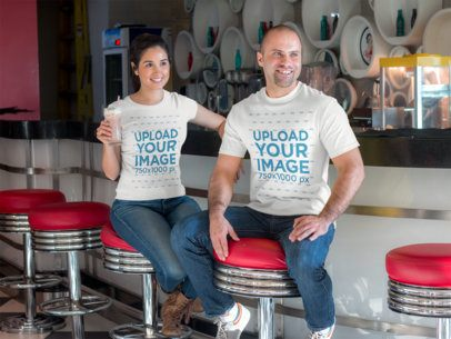 Bald Guy and Girl Wearing Different Tshirts Mockup While at a Restaurant a15555