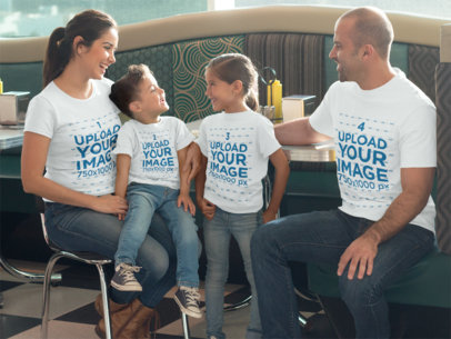 Family of Four Having a Reunion at a Restaurant While Wearing Different T-Shirts Mockup a15659