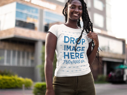 Smiling Black Girl Wearing a Round Neck Tee Mockup While in the City a15564