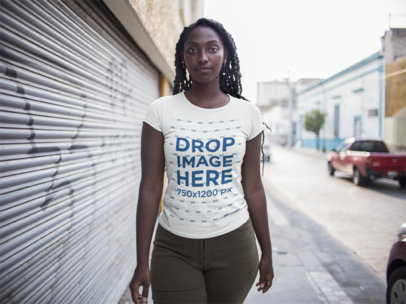 Mockup of a Black Girl Facing the Camera Wearing a Round Neck Tee While Outdoors a15557