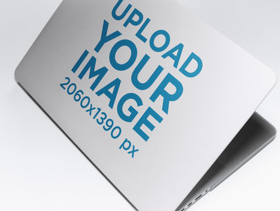 Angled Mockup of a Laptop Cover Lying on a Solid Surface a15339