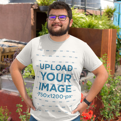 Young Man on the Rooftop While Wearing a Plus Size T-Shirt Mockup a15527