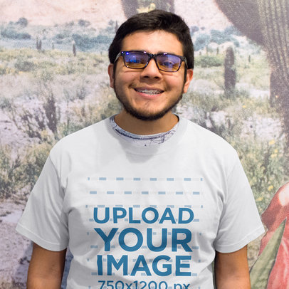 Happy Young Customer Wearing a Tee Mockup While Standing a15664