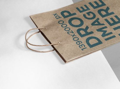 Angled Mockup of a Paper Bag Lying on a Bicolor Surface a15303