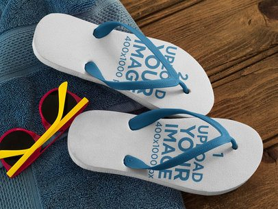 Two Flip Flops Template Lying on a Blue Towel on a Wooden Seat a15441