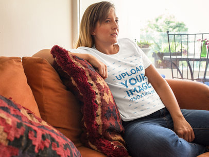 Serious Woman Wearing a Round Neck Tee Mockup While Sitting on her Sofa a15768