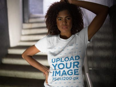 Black Girl Hiding on Stairways While Wearing a Round Neck T-Shirt Mockup a15834