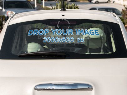 Car Window Decal Mockup on the Back Window of a White Car a15354