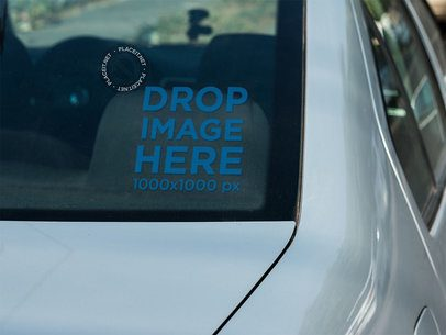 Small Square Decal Mockup on the Back Window of a Car a15355