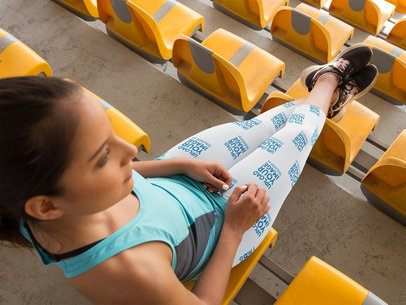Top Shot of a Girl Watching a Competition While at a Stadium Wearing Leggings Template a15327