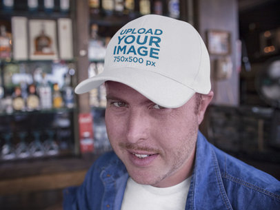 Middle Aged Guy with Dad Hat Mockup at a Bar a15885