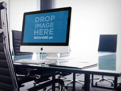 iMac in a Conference Room on Top of a Glass Table Mockup a4783