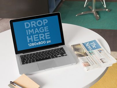 Laptop Mockup Featuring a Macbook Pro at a Design Office a5487