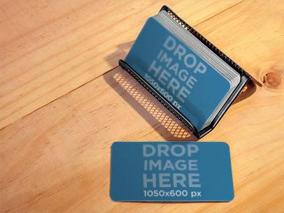 Business Cards Placed Over a Metal Business Cardholder Mockup a6298