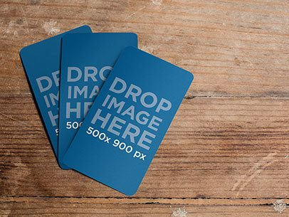 Mockup Featuring Three Business Cards Lying on Top of a Wooden Table a6289