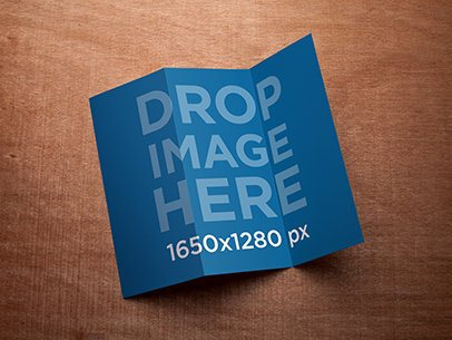 Mockup of a 3 Panel Brochure Lying on Top of a Wooden Surface a6214