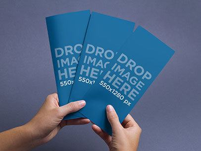 Brochure Mockup of a Person Holding 3 Brochures Against a Colored Backdrop a6348