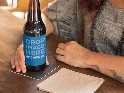 Label Mockup of a Tattooed Woman Having a Beer at a Bar a6857