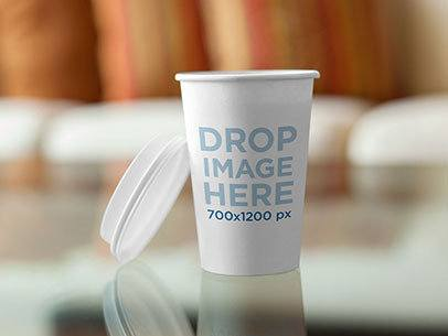 Takeaway Coffee Cup on Top of a Glass Coffee Table Label Mockup a5846