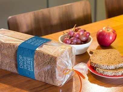 Label Mockup of a Packaged Loaf of Bread on Top of a Table a7267