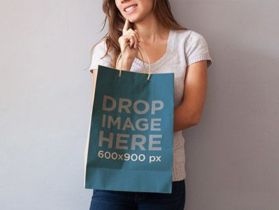 Paper Bag Mockup of a Woman Holding a Shopping Bag a6974