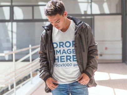 T-Shirt Mockup of a Young Man Walking Around 7291a