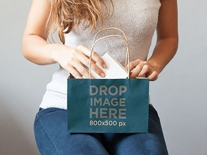 Paper Bag Mockup Featuring a Woman Opening a Gift a6976