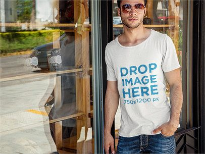 T-Shirt Mockup of a Young Man Leaning Against a Window 6508a