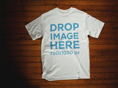 Mockup Template of a T-Shirt Lying Over a Wooden Surface 6404a
