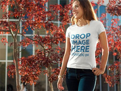 T-Shirt Mockup of a Woman Taking a Stroll Around Town 6600a