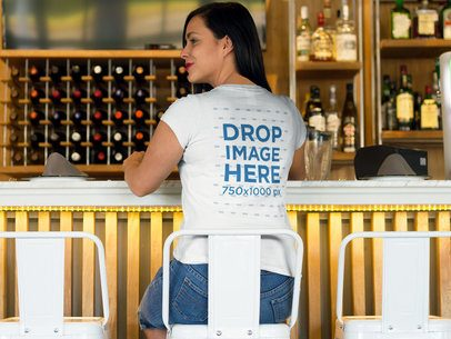 Back Shot of a Woman Sitting at a Bar T-Shirt Mockup a8503