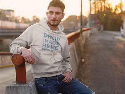 Hoodie Mockup of a Man Standing Next to a Bridge a8904