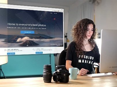 App Demo Video of a Woman Working on Her iMac in a Photo Studio 8879a