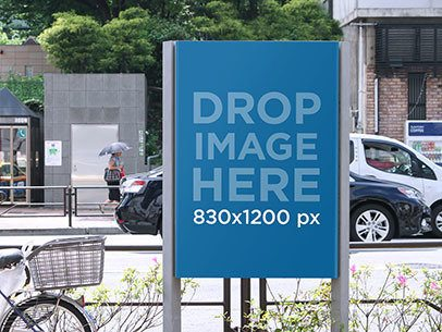 Vertical Banner Mockup on a Sidewalk at a Busy Street a10467
