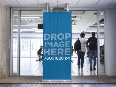 Vertical Banner Mockup Standing Outside a Classroom a10606