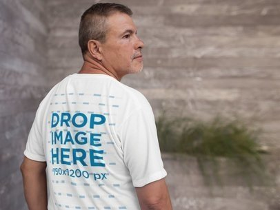 Back of a Middle Aged Man Wearing a Tshirt Mockup a10818b