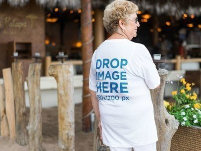 Back of an Elder Woman Wearing a T-Shirt Mockup while at the Beach a10936b