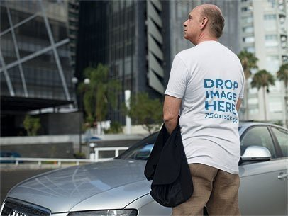 Back of a Senior Man Wearing a T-Shirt Mockup Carrying his Jacket in the City a11123b