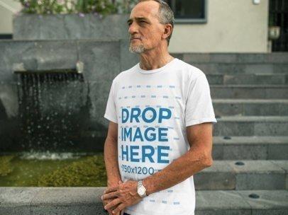 White Senior Man Wearing a T-Shirt in an Urban Space a10985