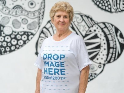 Senior White Woman Wearing a T-Shirt in an Urban Space a10937