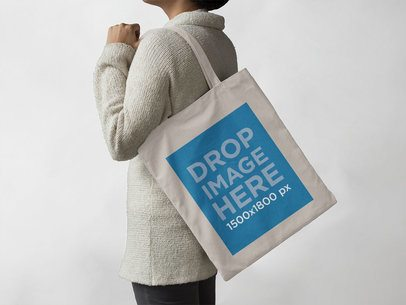 Canvas Tote Bag Mockup Carried by a Woman a11436