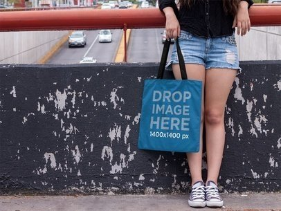 Street Style Woman Holding a Tote Bag Mockup a11462