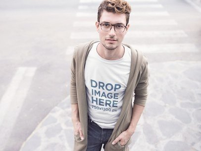 Young Hipster Wearing a Tee and Glasses in the Street Mockup a11535
