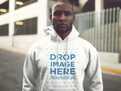 Serious Young Black Man Wearing a Pullover Hoodie Out in the Street a12564