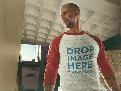 Raglan T-Shirt Mockup of a White Middle-Aged Man Standing Inside a City Building a12615